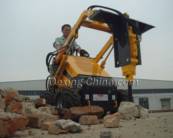 Mini skid loader with auger